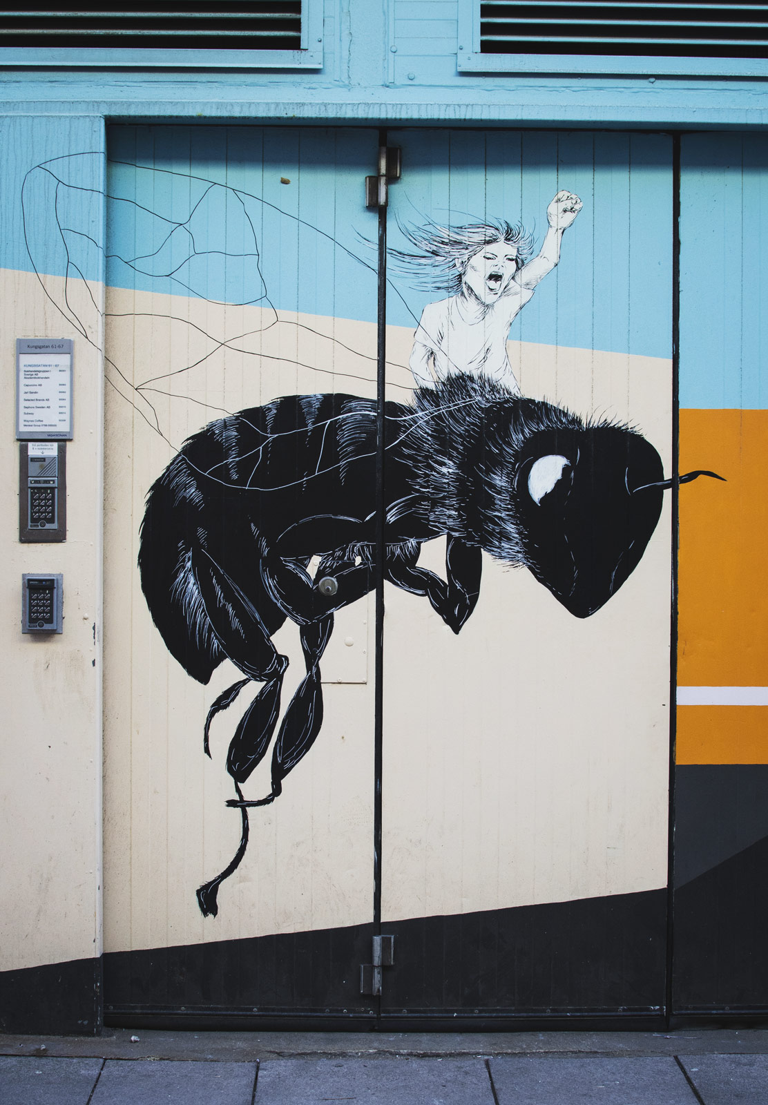 Bee painting on door