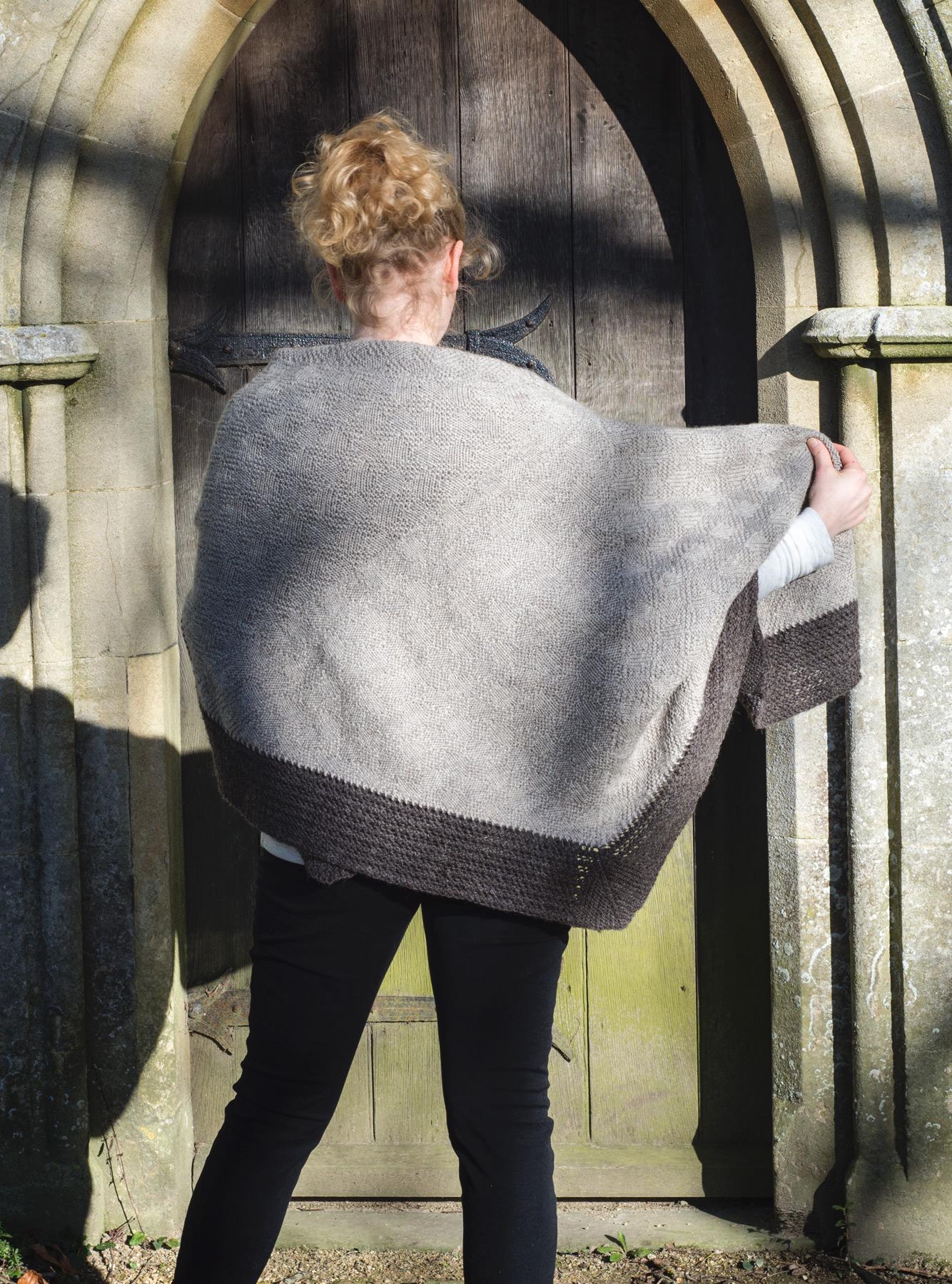 Woman standing old doorway