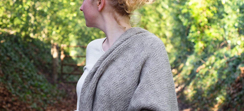 Shawl draped over shoulder