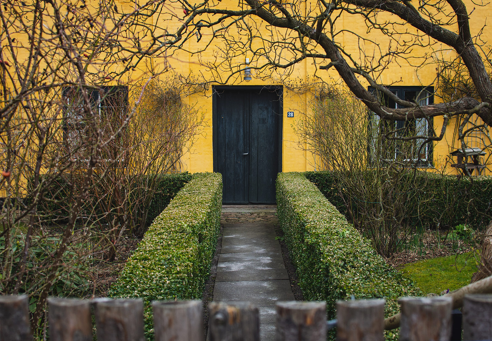 Black door on yellow building