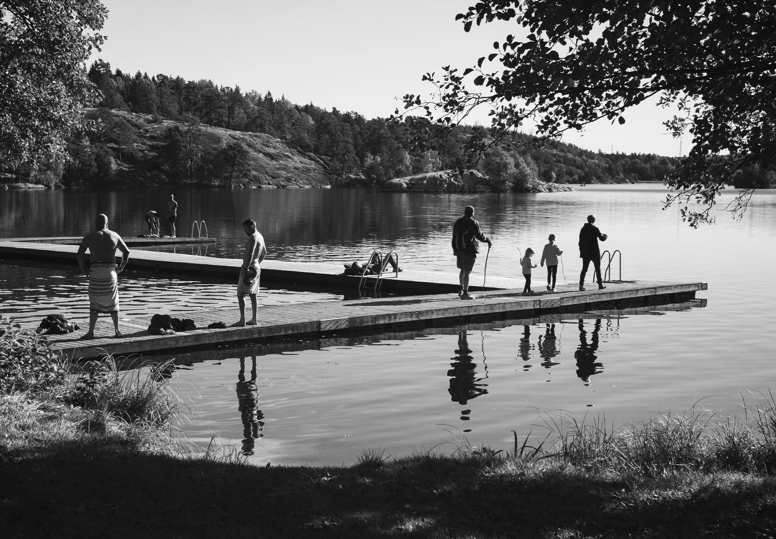 Swimmers on jetty