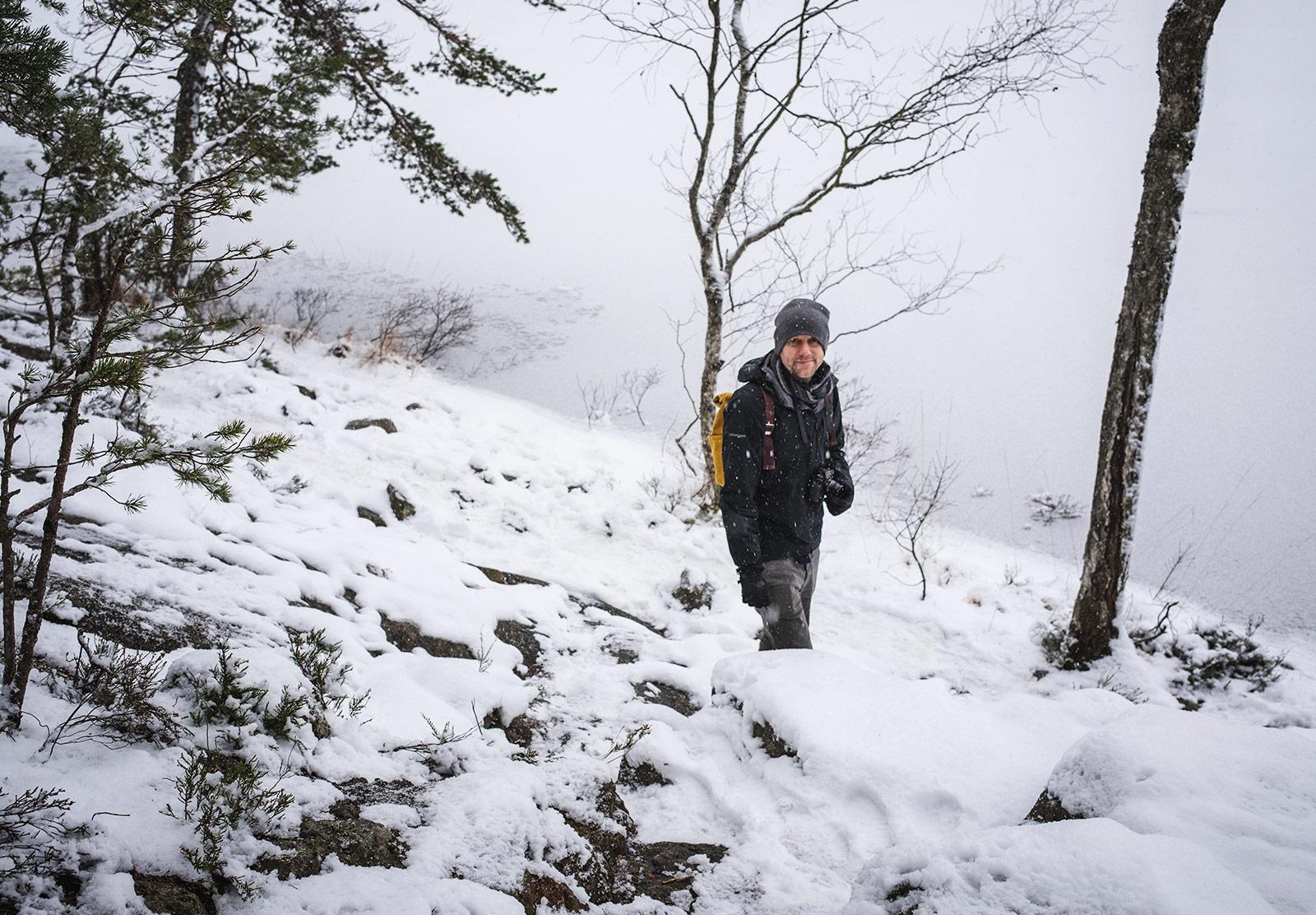 Man standing by frozen lake