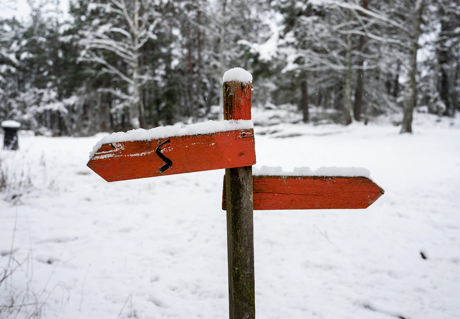 Red wooden sign