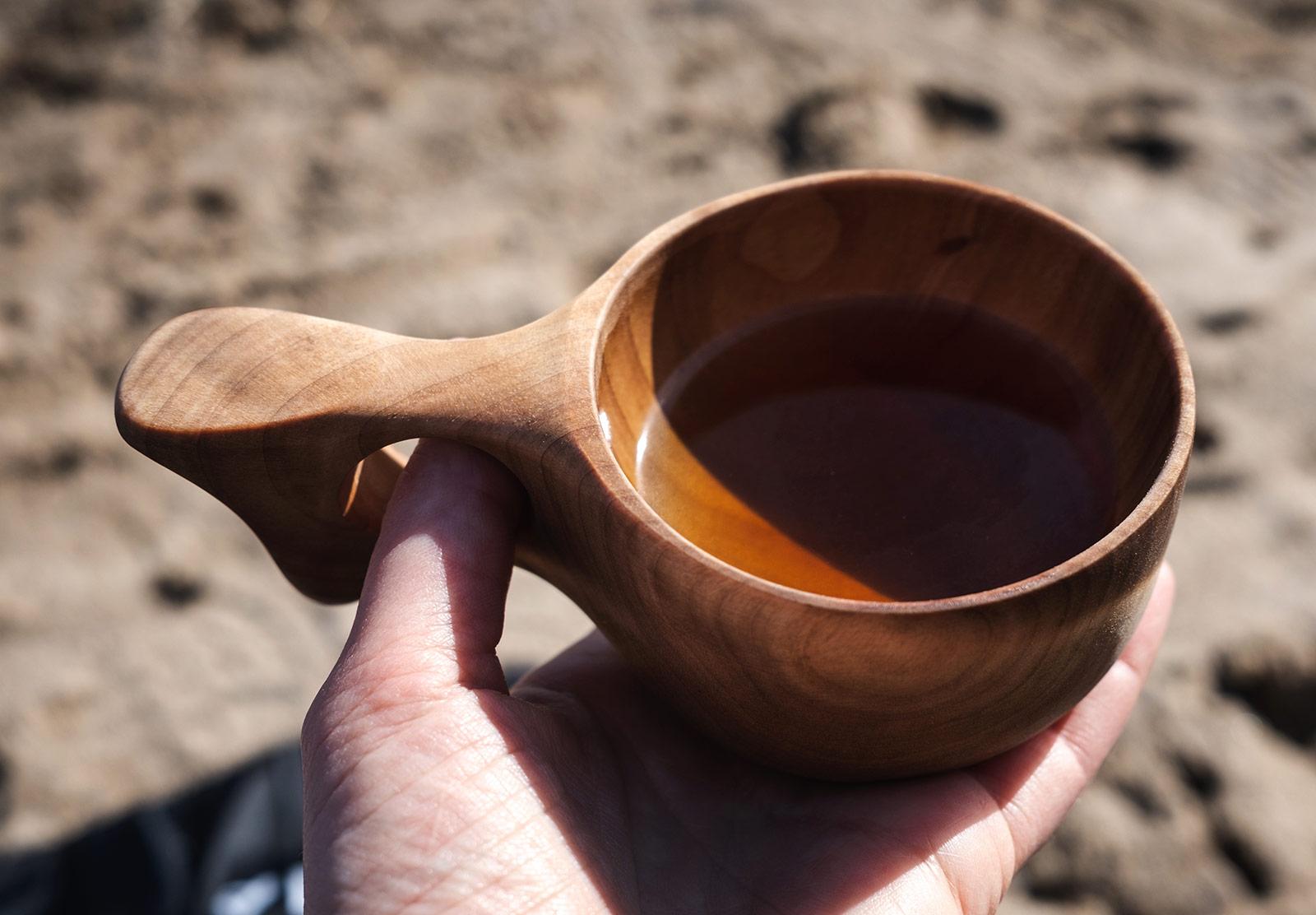 Tea in wooden cup