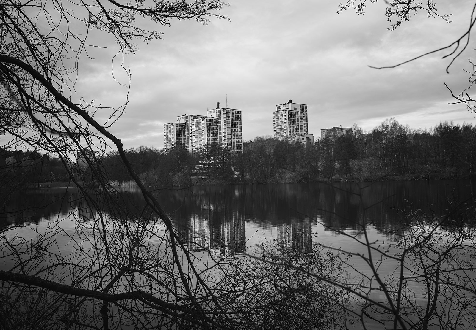 Tower blocks reflected in water