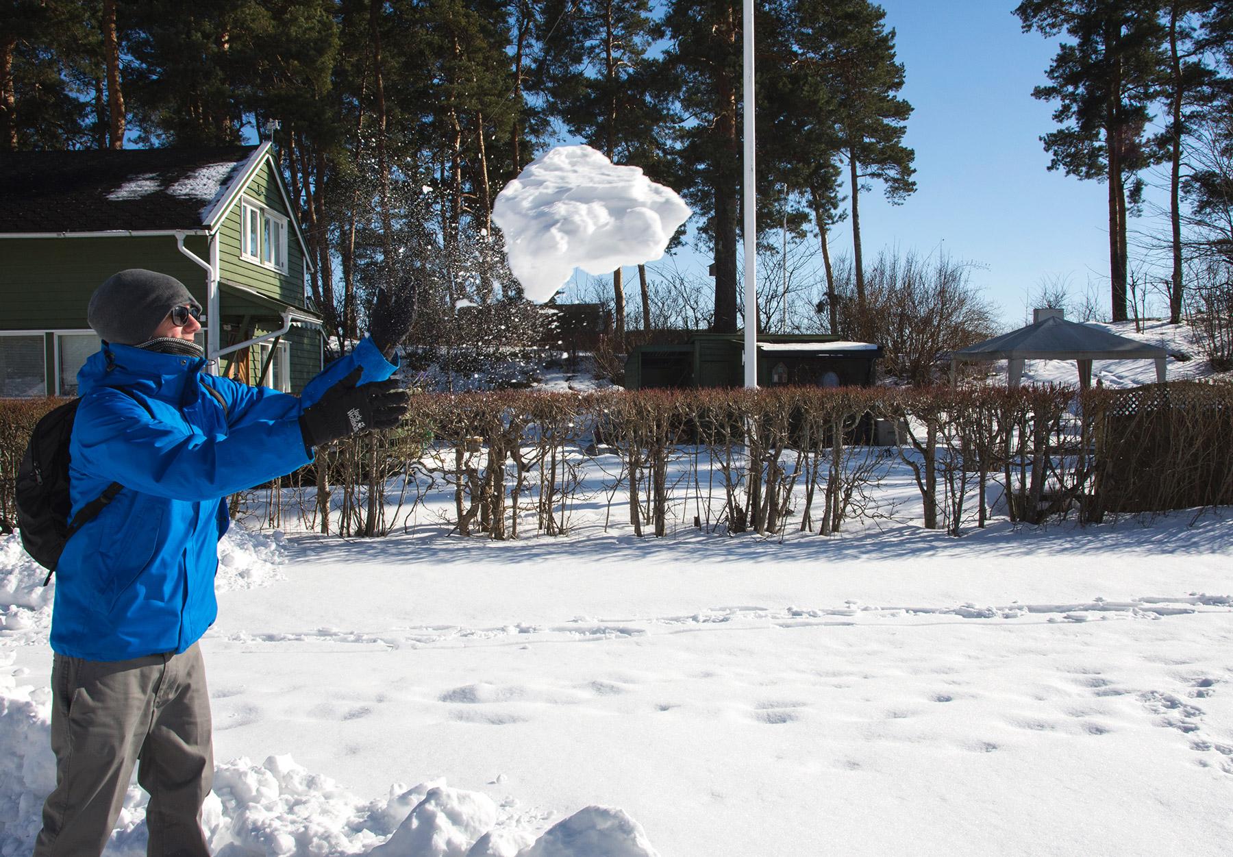 Man throwing giant snowball
