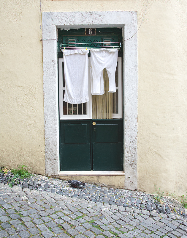 Laundry hanging over doorway