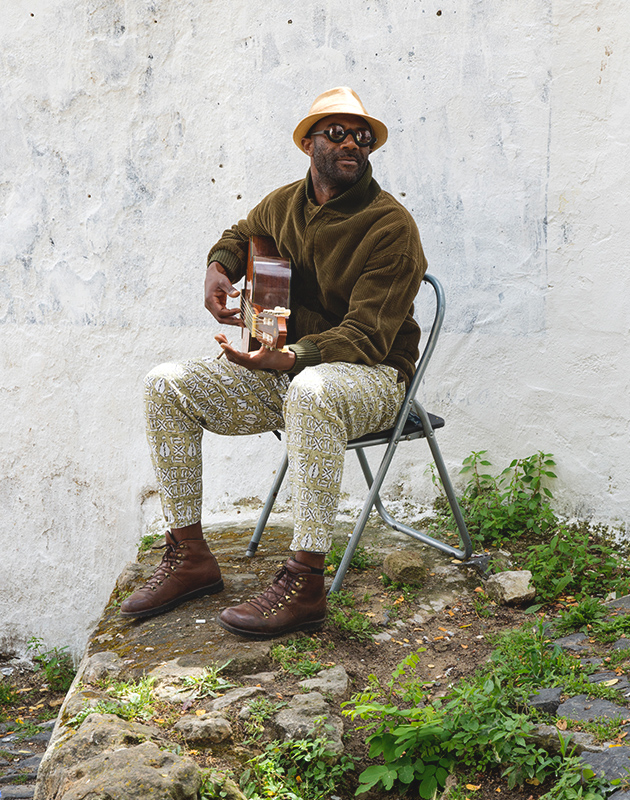 Sitting guitarist