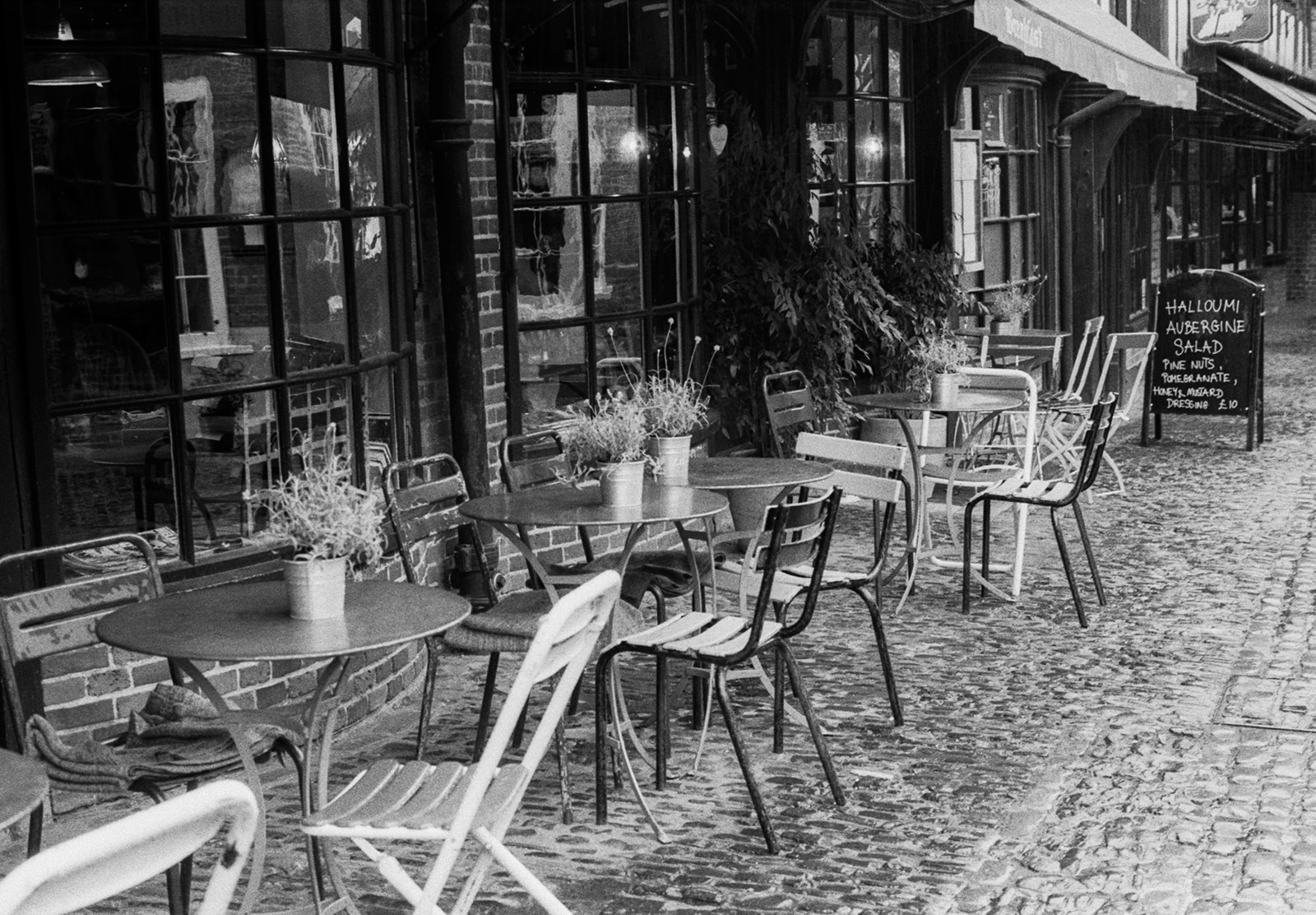 Tables and chairs on street