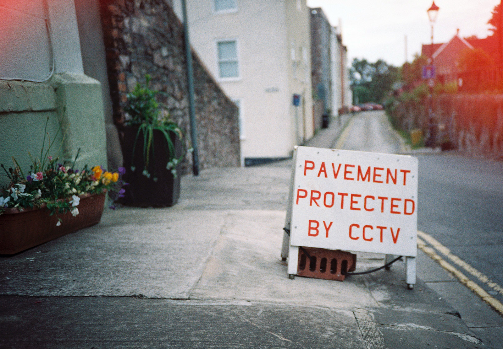 Pavement protected by CCTV sign