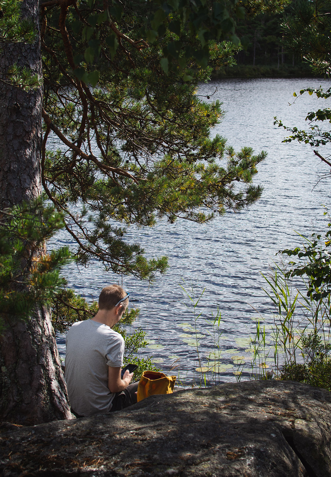 Man sat next to lake