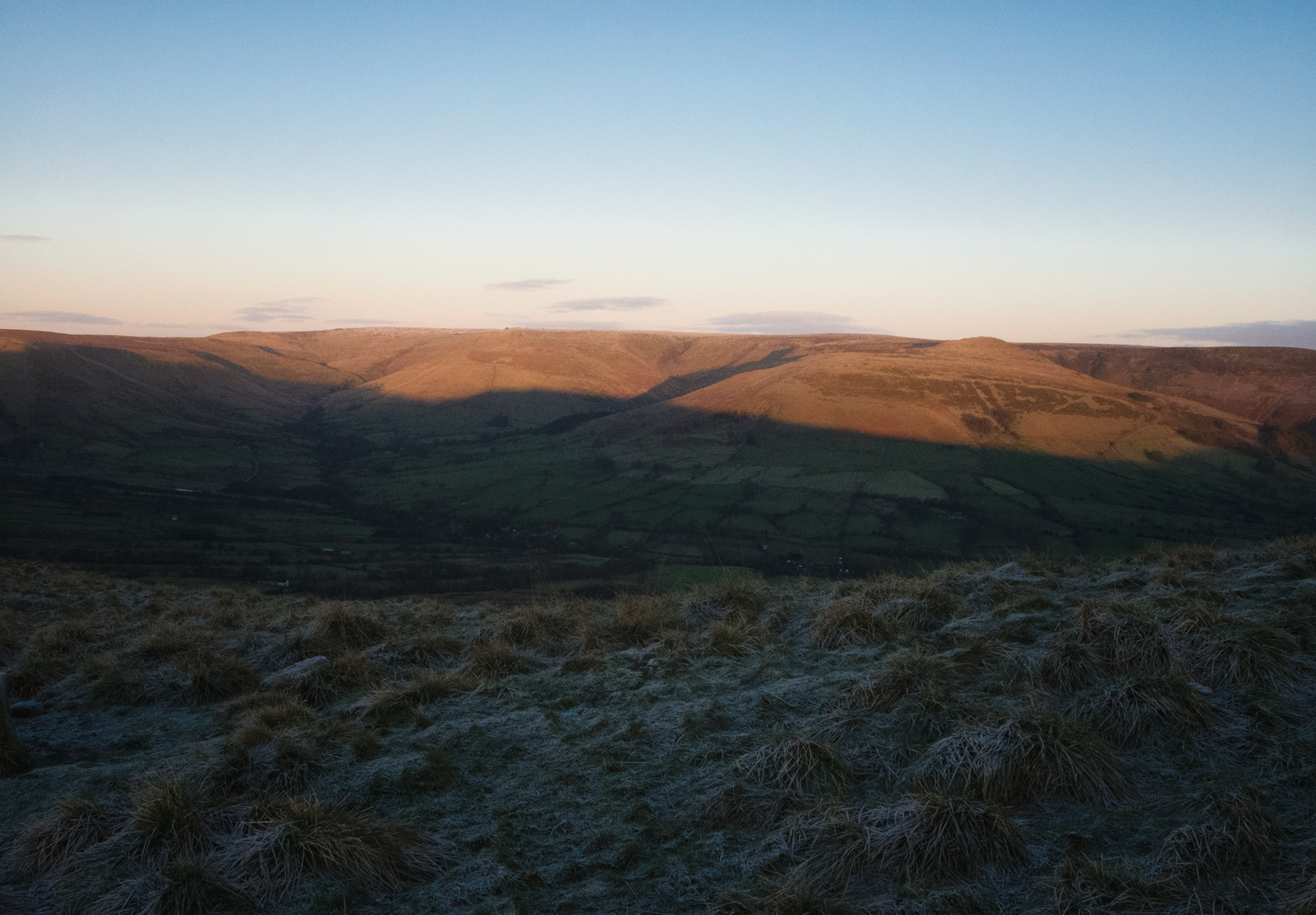 Sun shining on hills