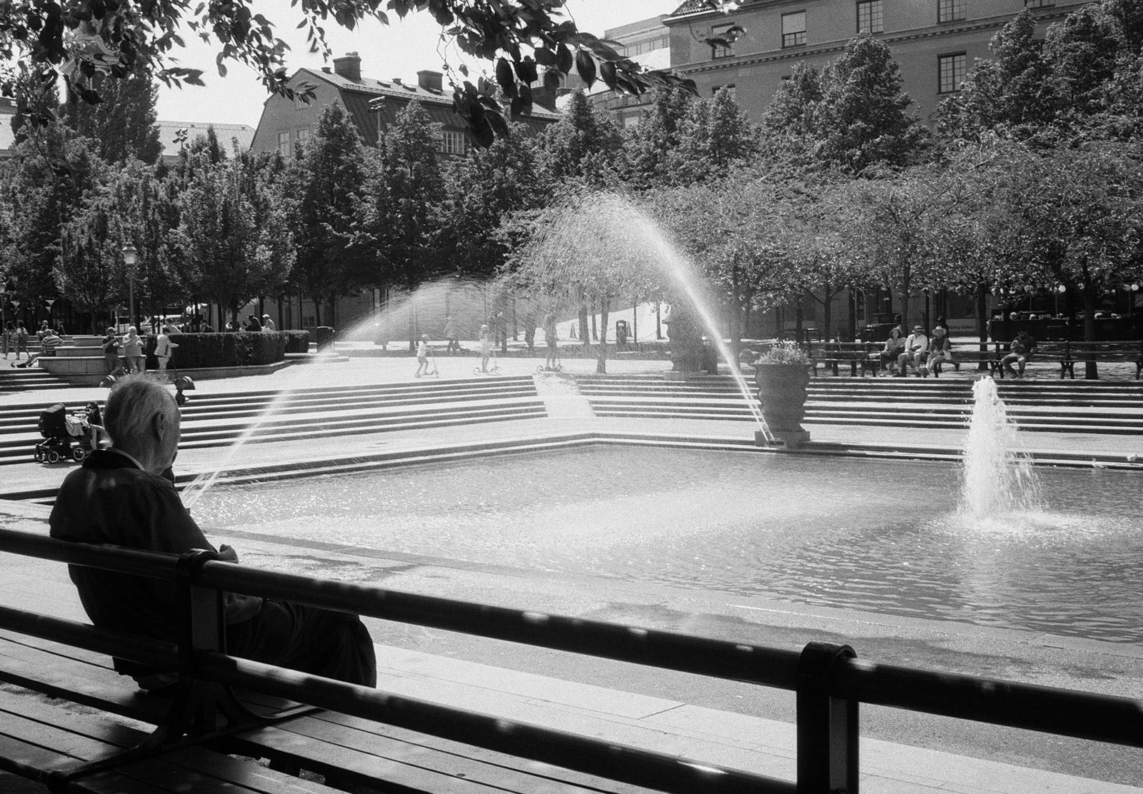 Man watching fountains