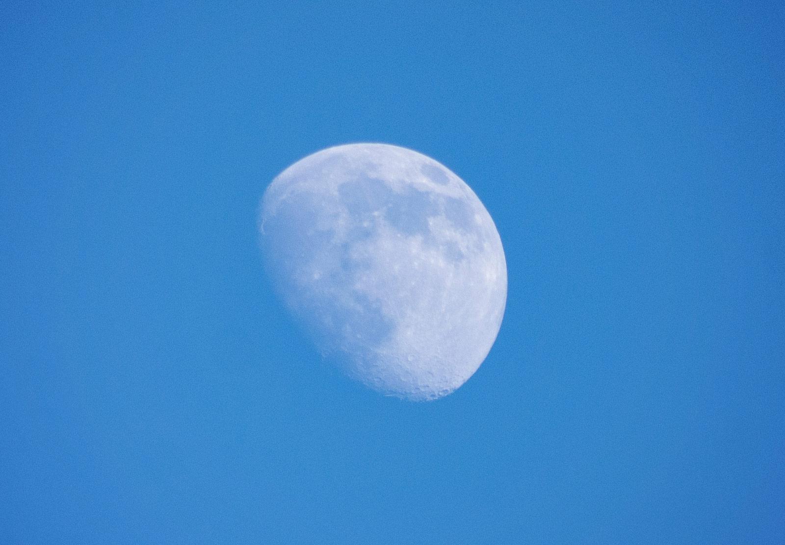 Moon against blue sky