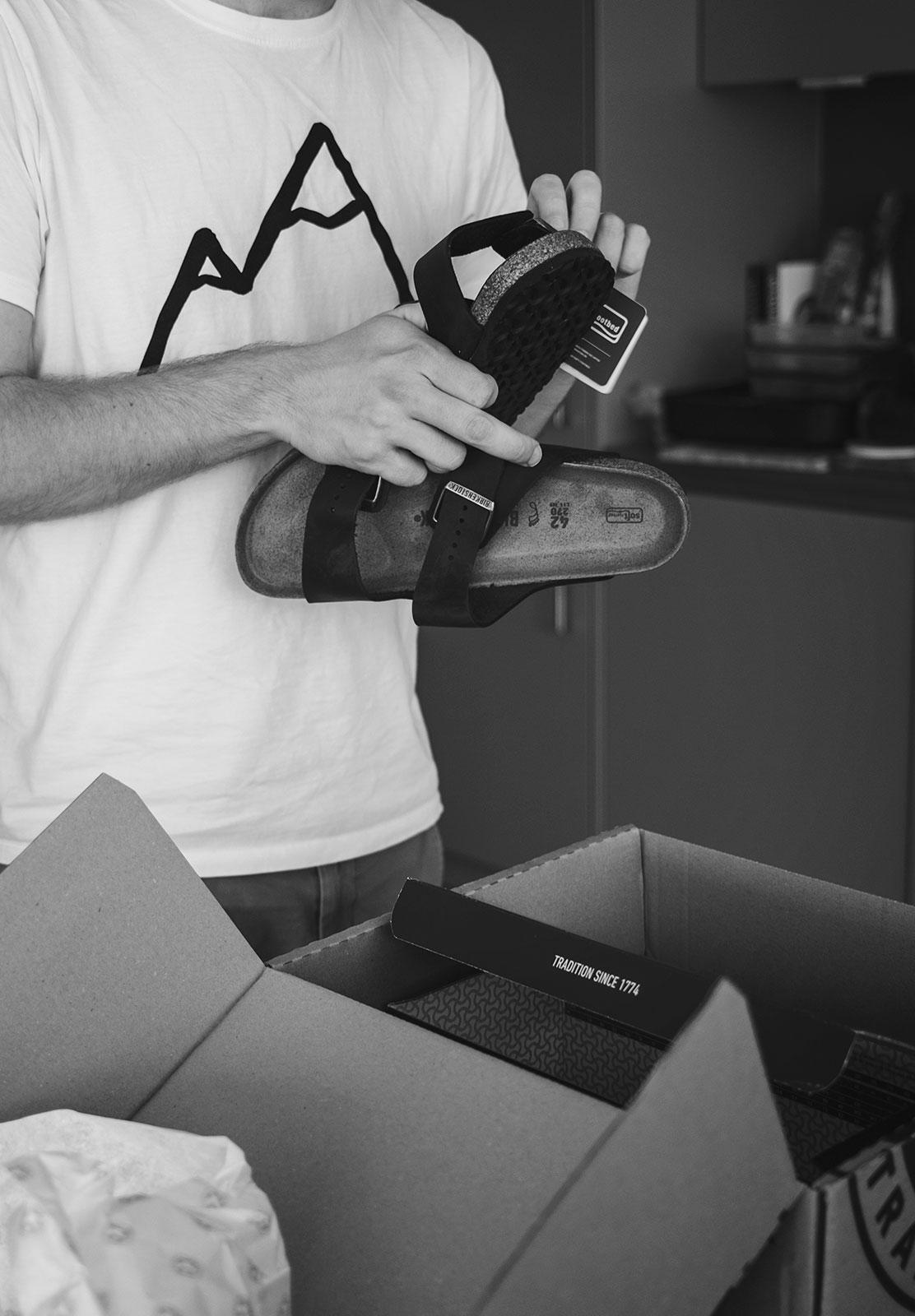 Man holding sandals