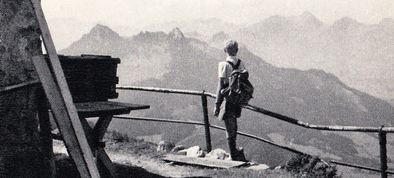 Boy overlooking mountains