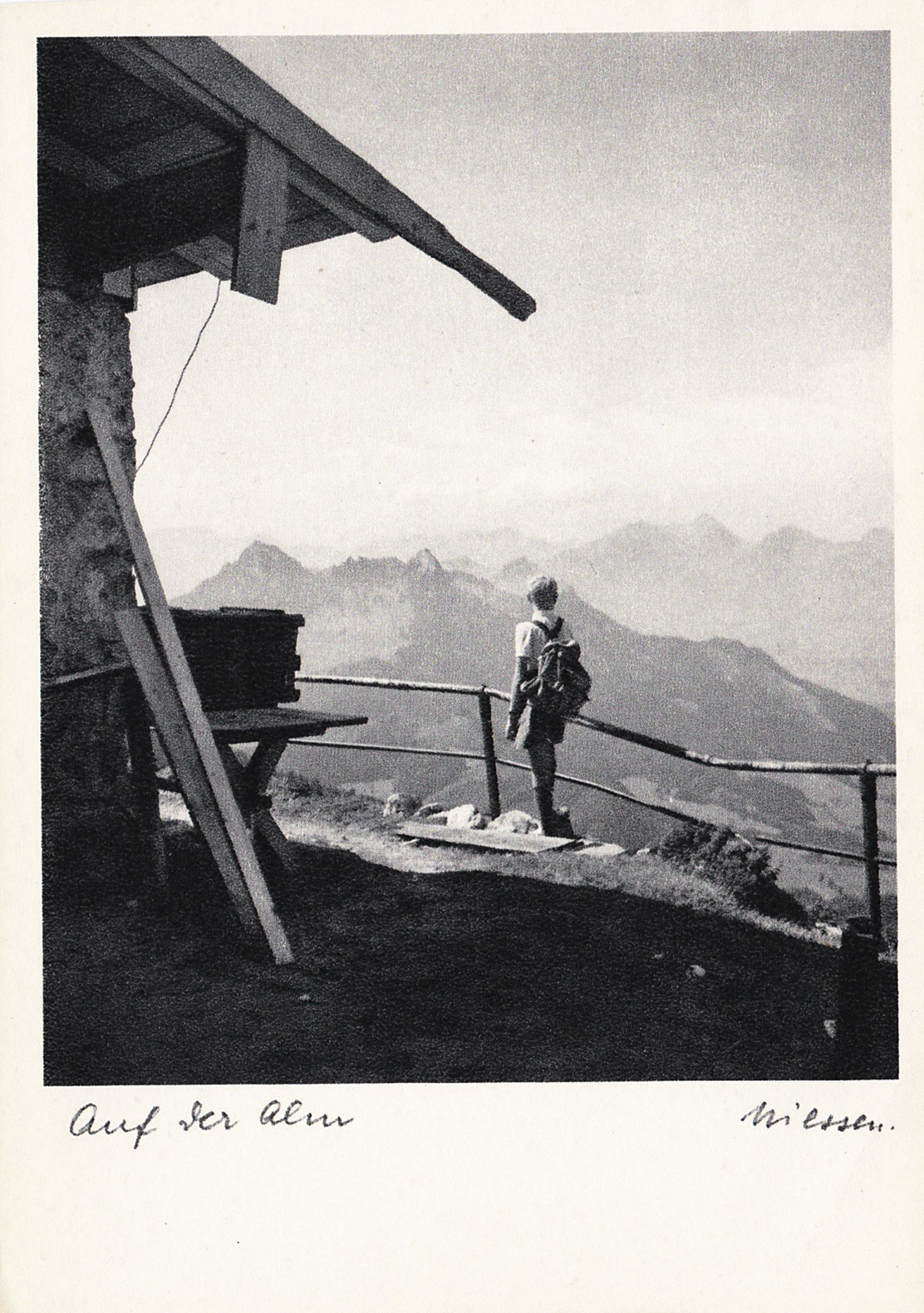 Boy overlooking mountains