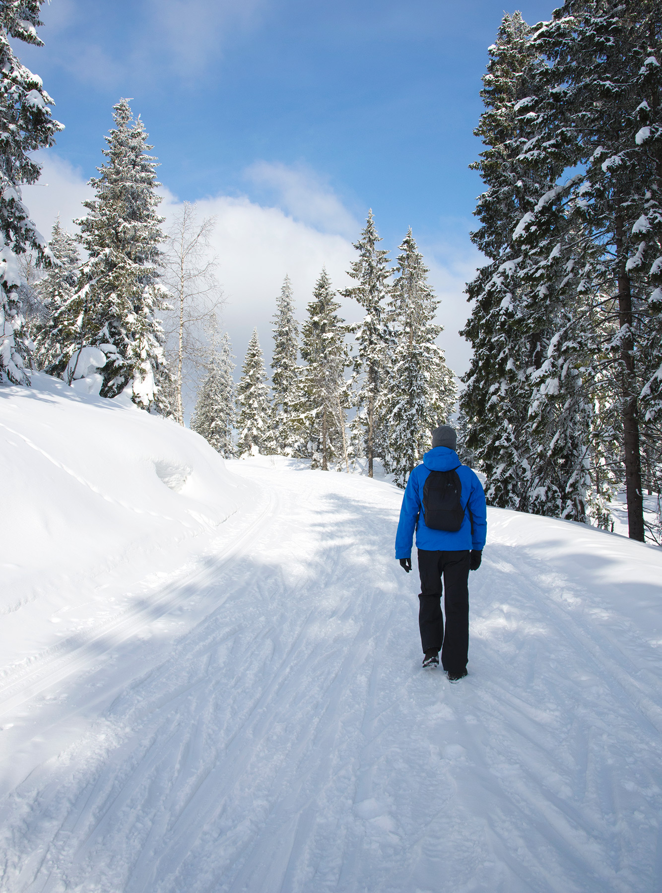 Man walking on snow trail