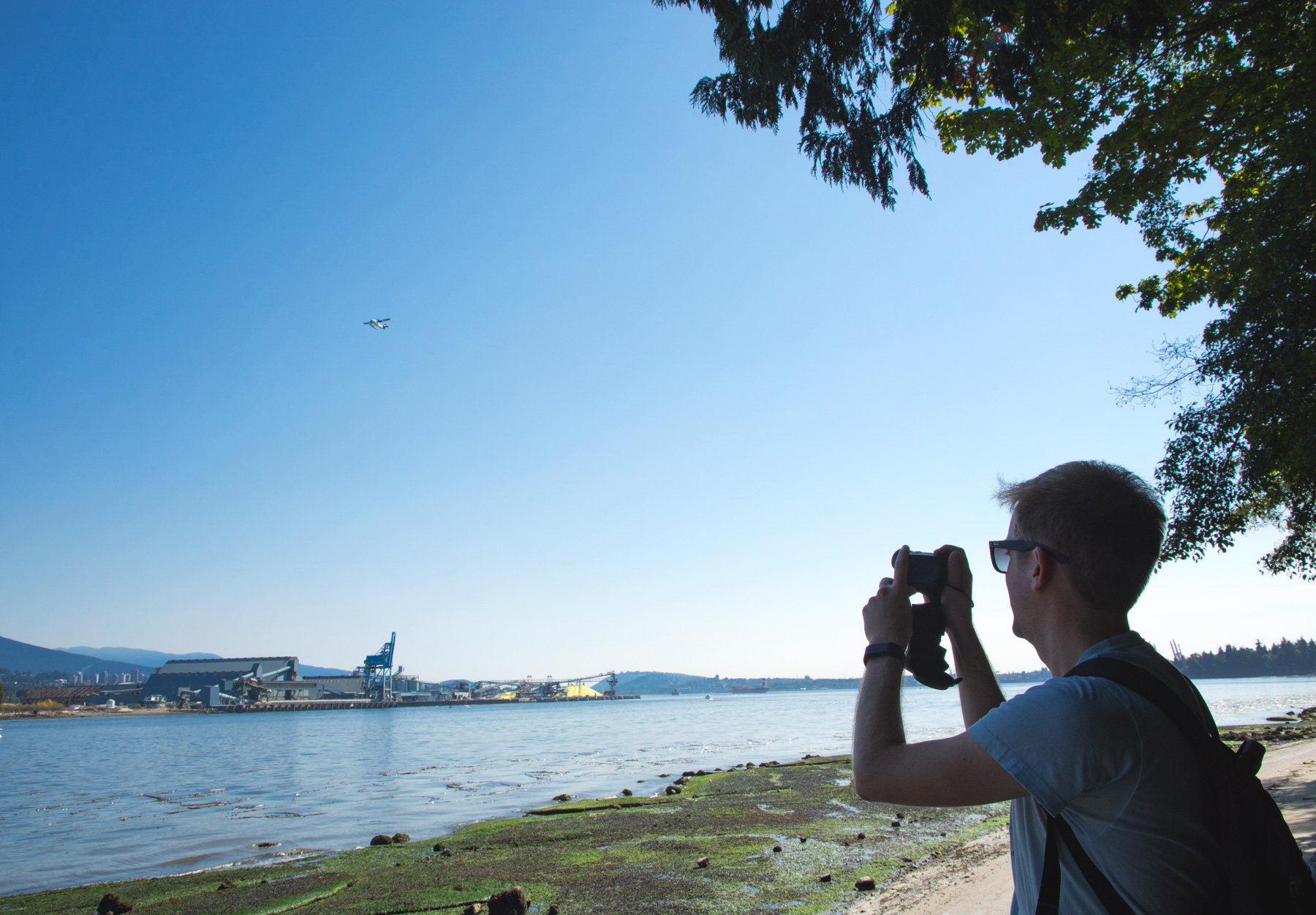 Man photographing seaplane