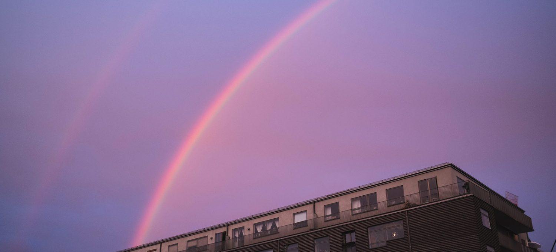 Pink rainbow in blue sky
