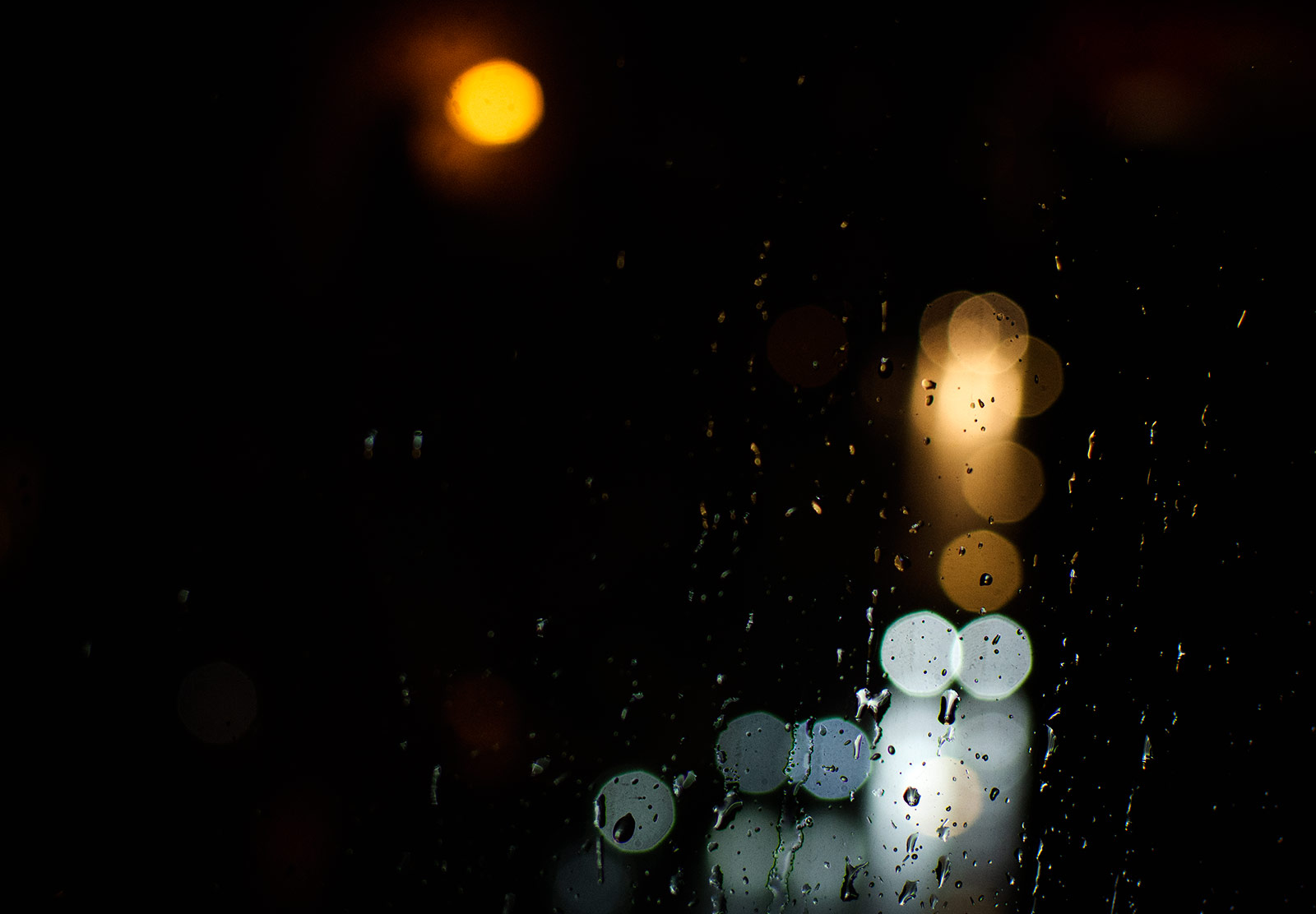 Lights through rain on window