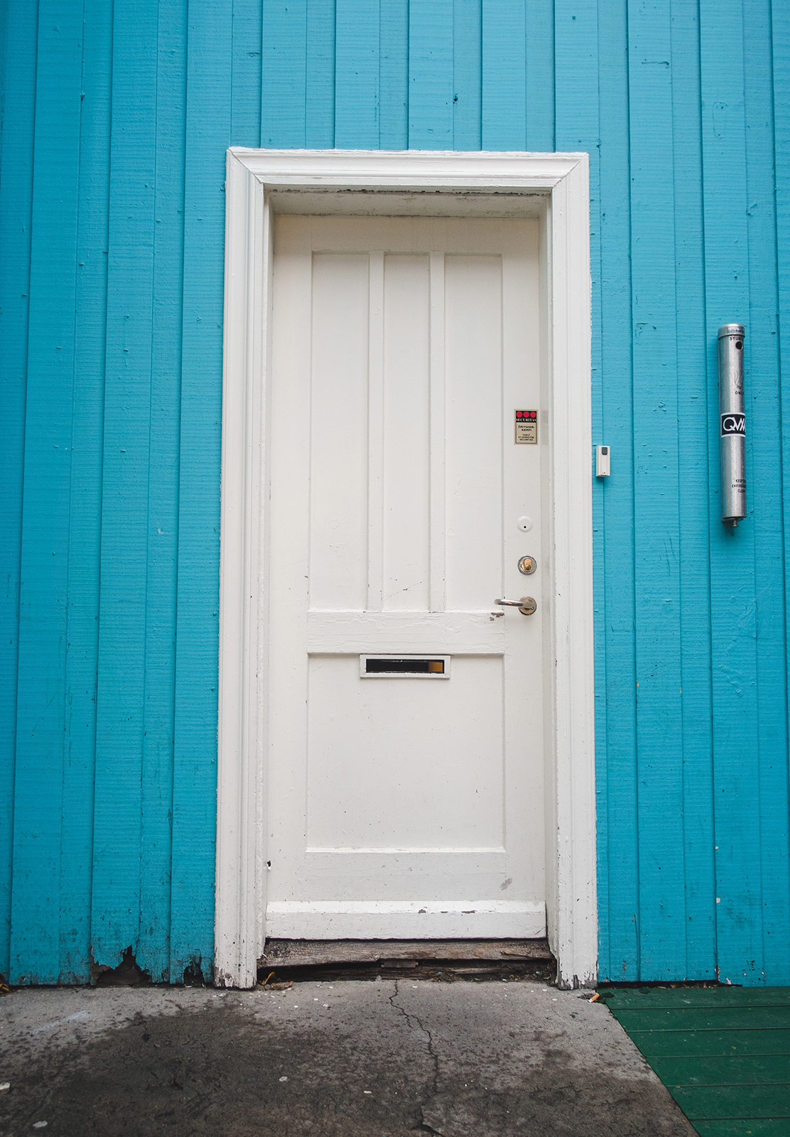 Blue wood and white door
