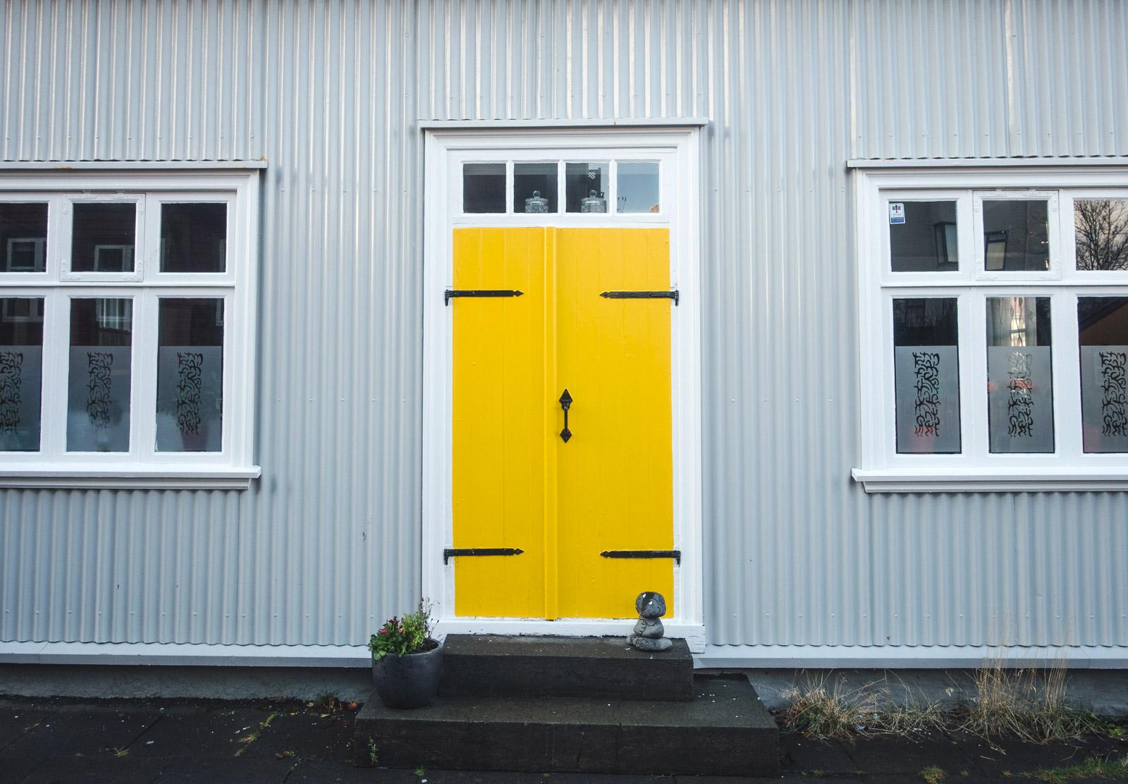 Grey building and yellow door