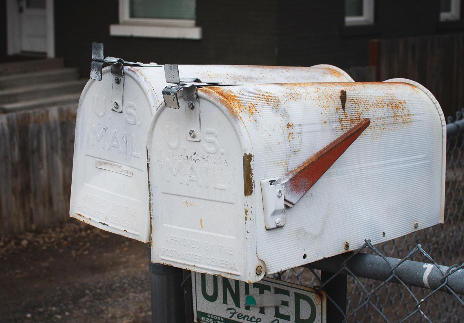 Rusty white mailbox