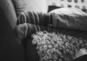 Foot on sofa