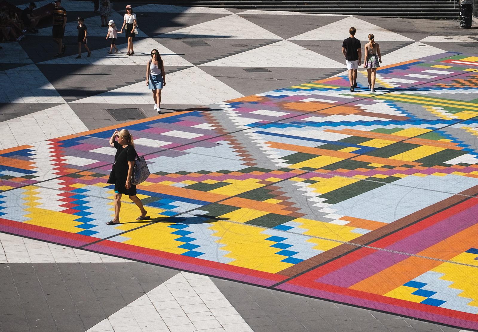 People walking on colourful floor