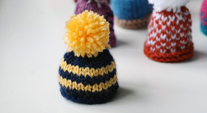 Blue and yellow stripe hat with bobble