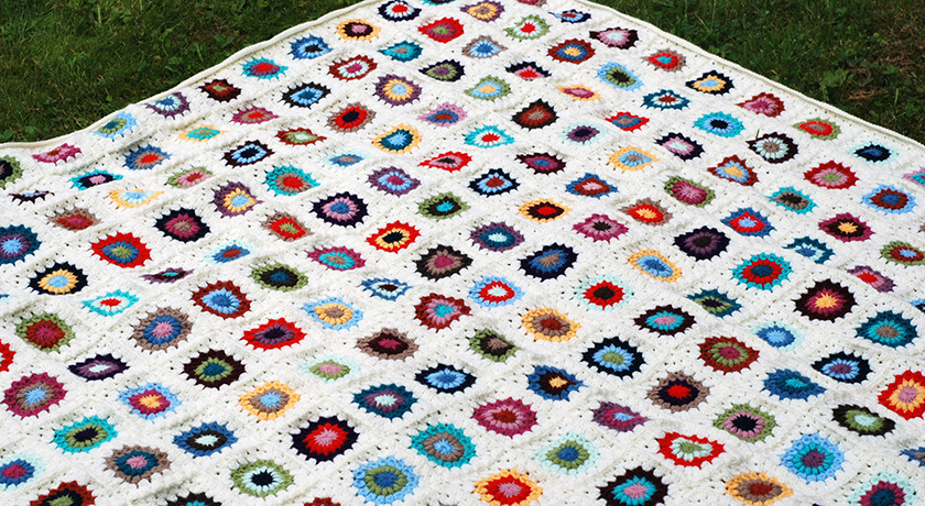 Blanket laid out on grass