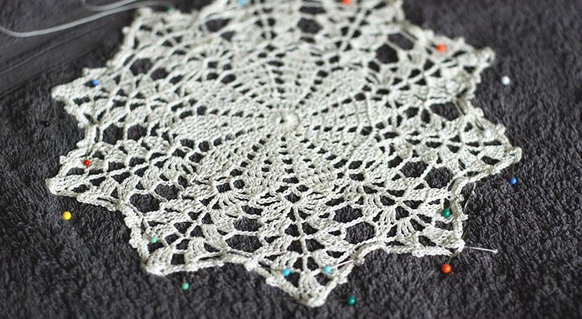 Wet doily pinned to a towel