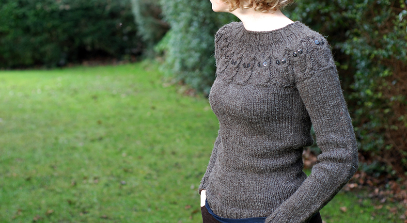 Side view of fitted owl jumper