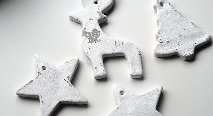 Christmas decorations painted white with peeling paint
