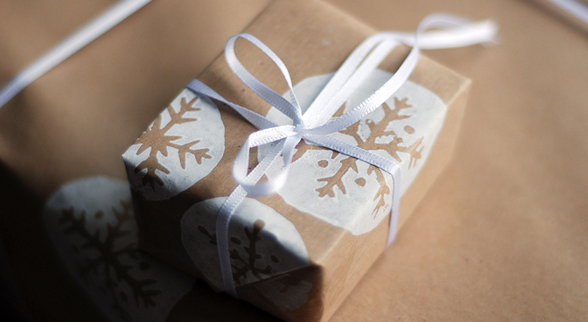 Brown snowflake wrapping with white ribbon