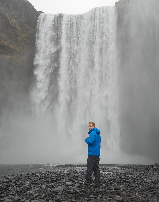 Scott in front of waterfall