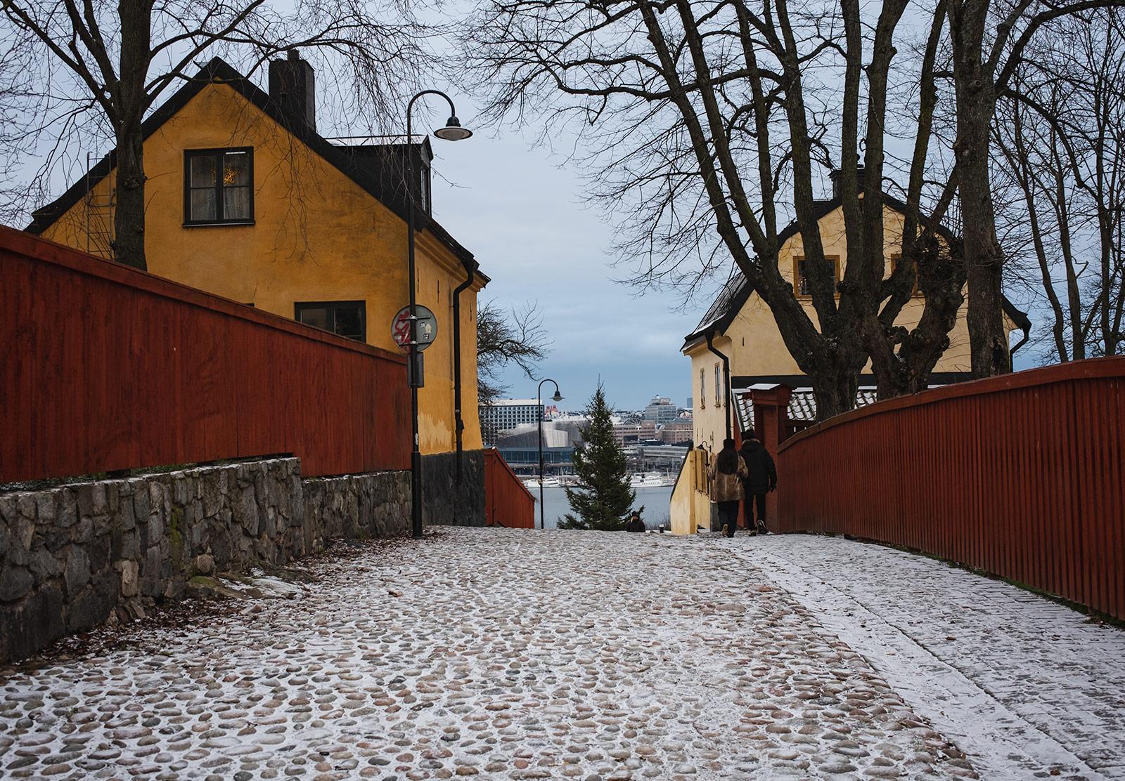 Snow on cobbled street