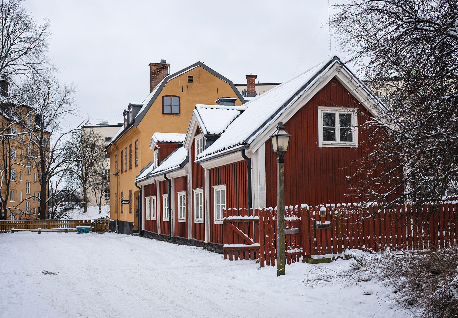 Wooden buildings in the snow