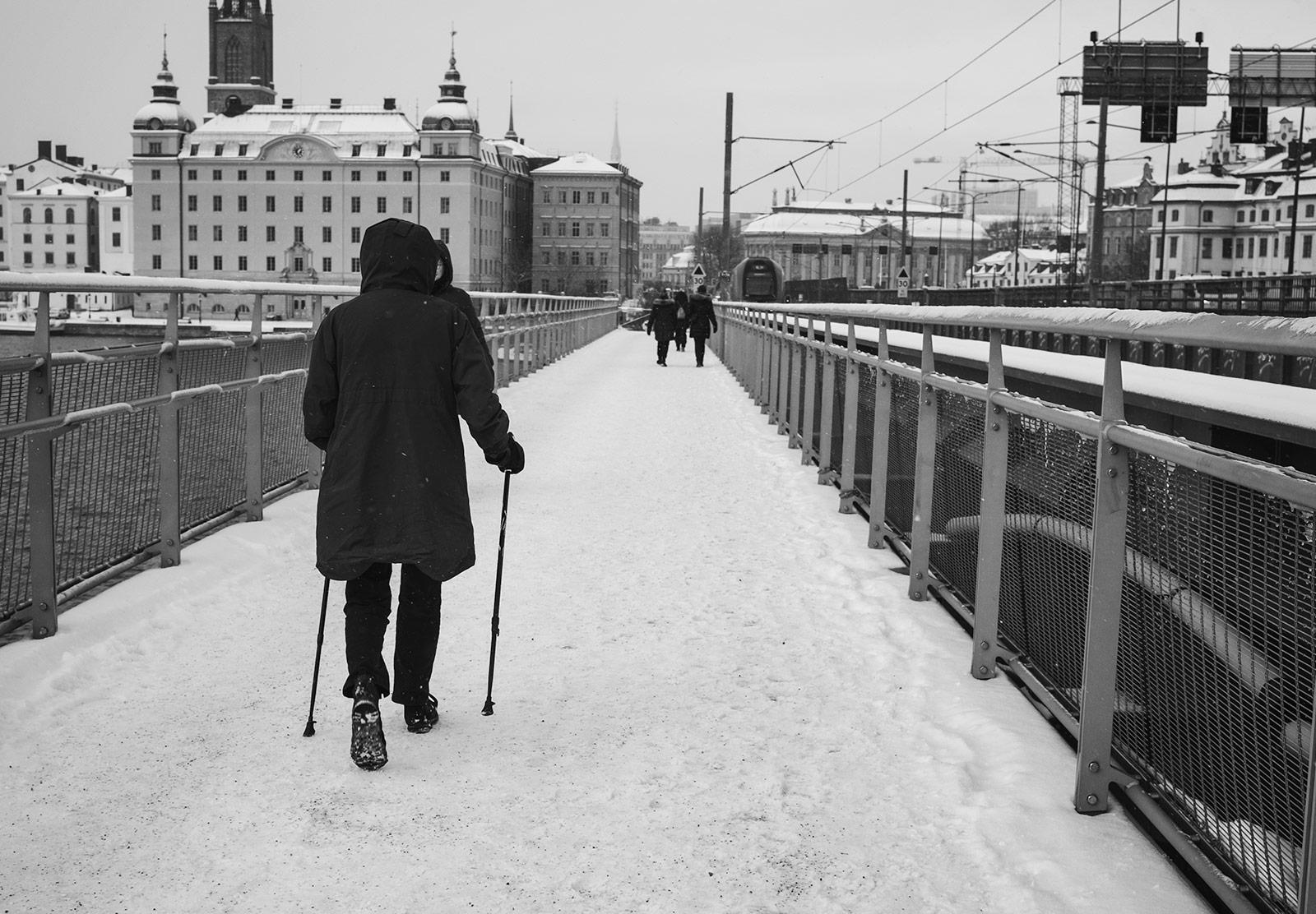 Woman walking with sticks