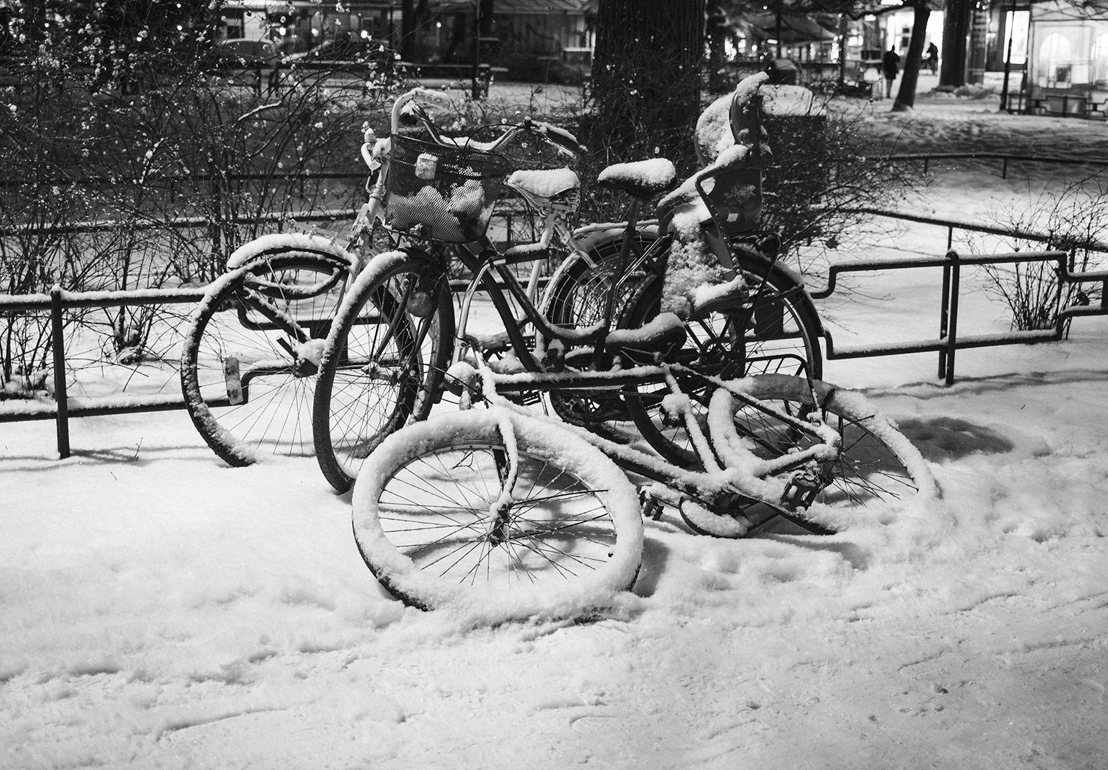 Snow covered bikes