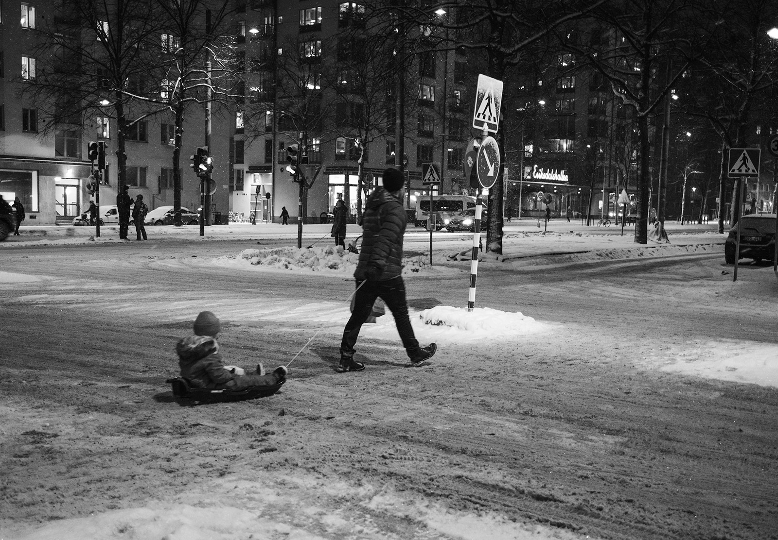 Man pulling child in sledge