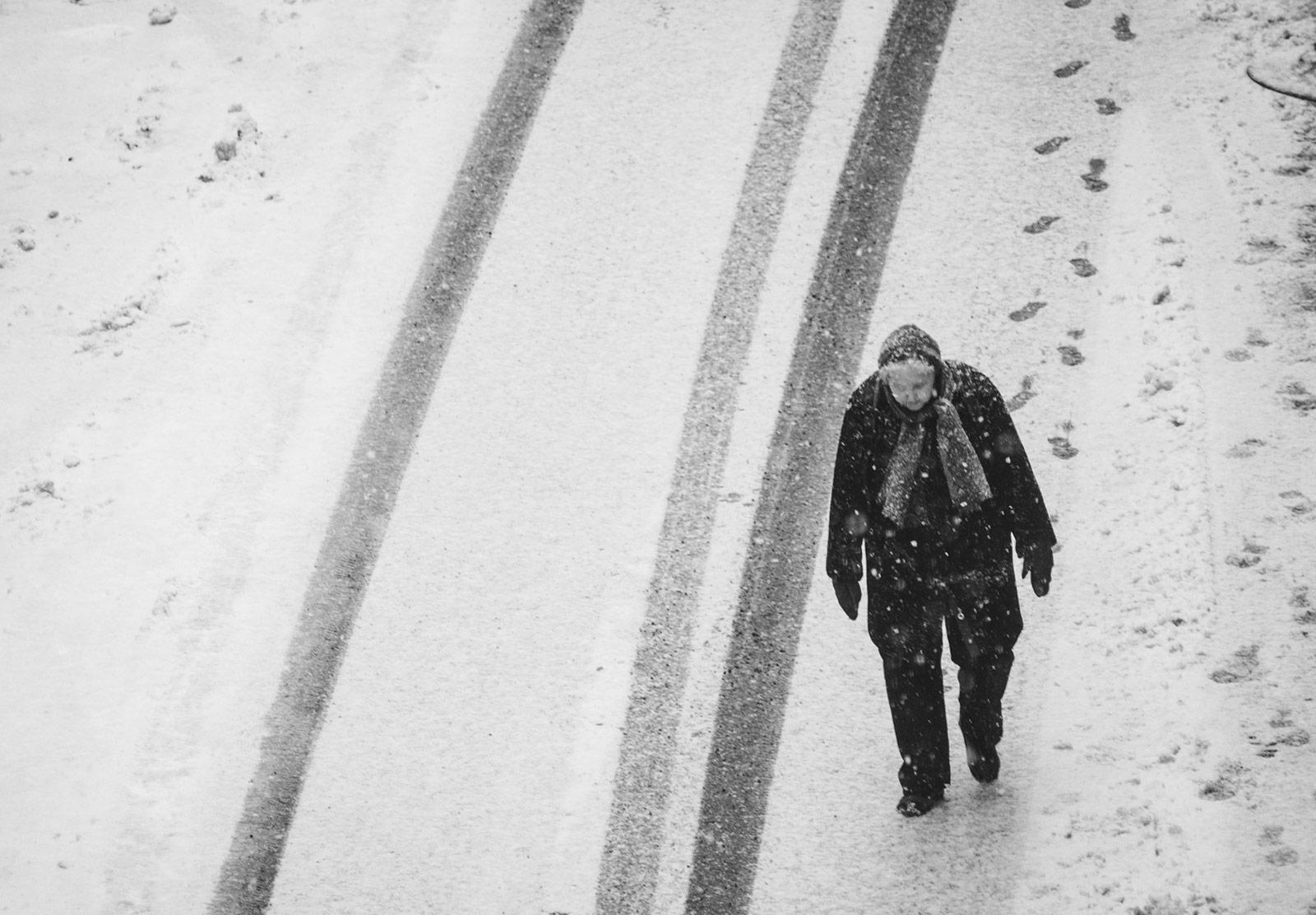 Elderly lady walking in snow