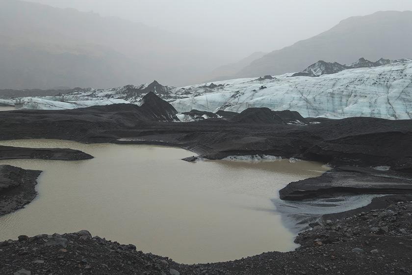 Blue glacier ice and black sand