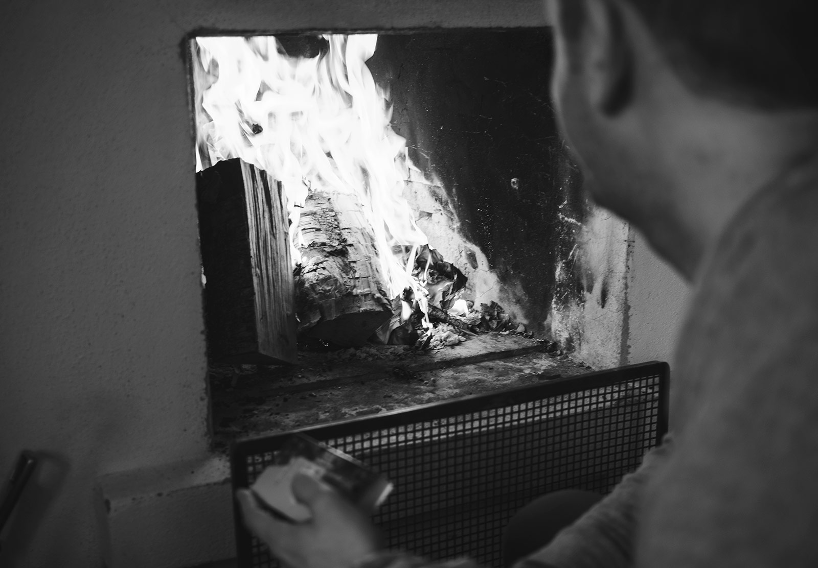 Man looking at fire