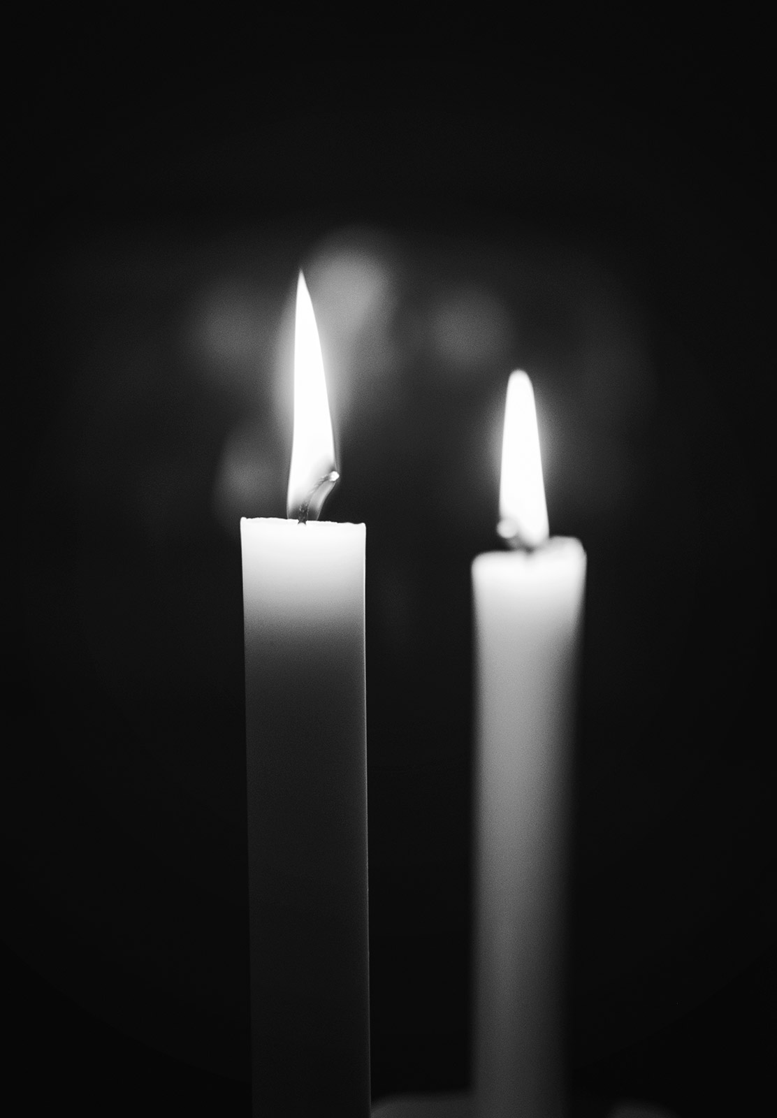Candle flames in the dark