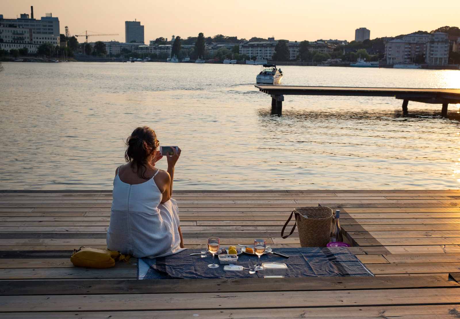 Woman photographing sunset