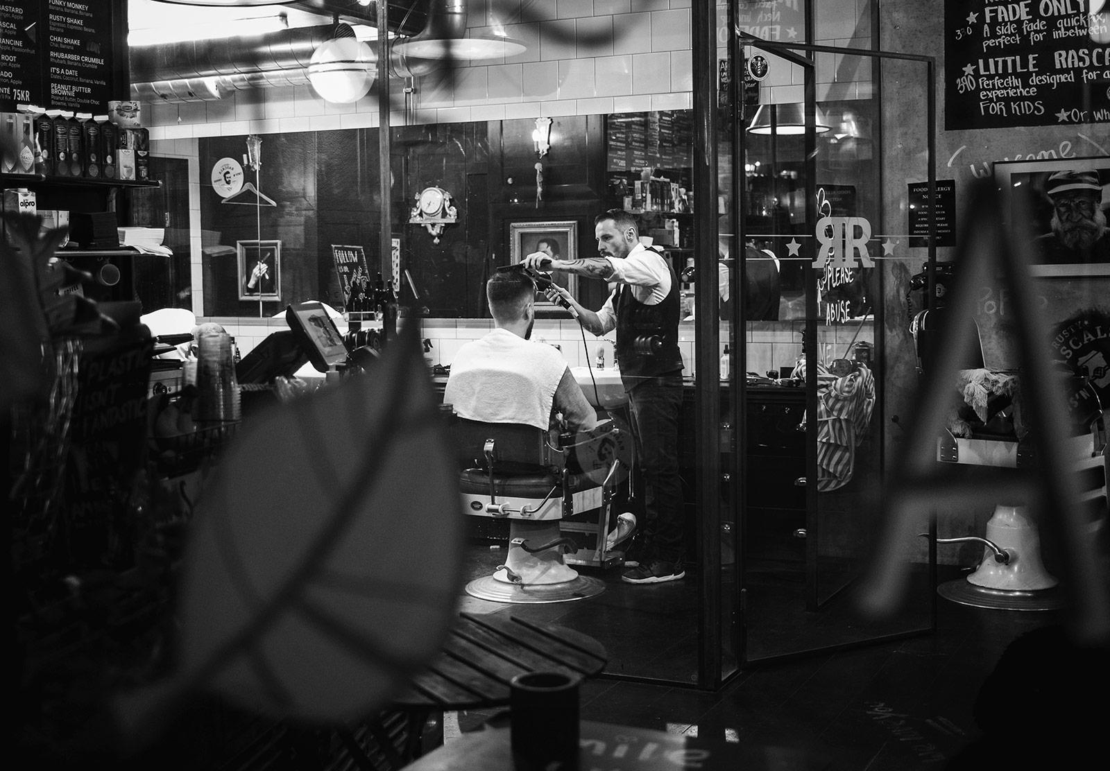 Man sat in barber chair