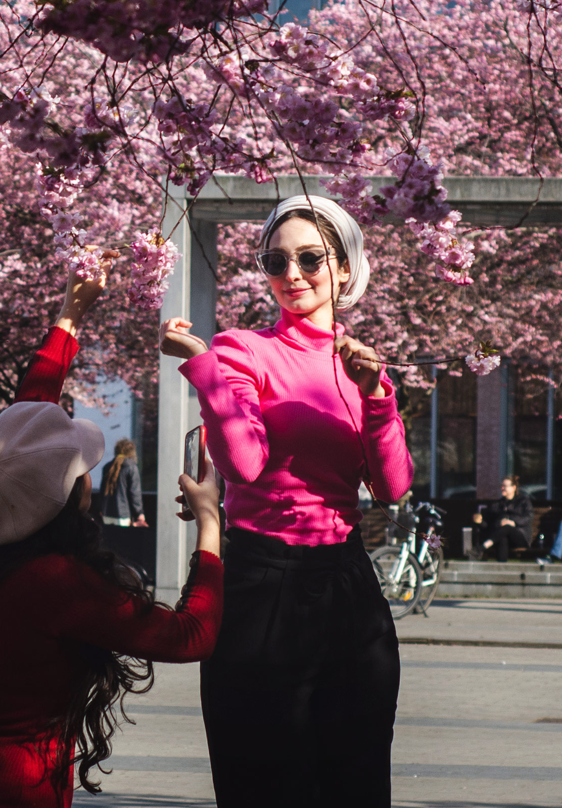 Woman standing in cherry blossom branches