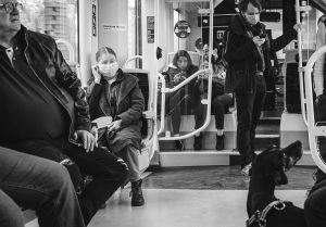 People in masks on a tram